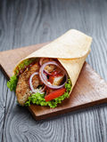 Tasty fresh wrap sandwich with chicken and vegetables Stock Photography