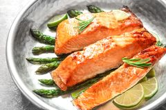 Tasty freshly cooked salmon in frying pan. Closeup Stock Photography