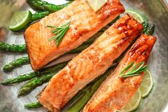 Tasty freshly cooked salmon in frying pan Stock Image