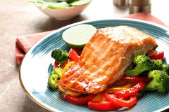 Tasty freshly cooked salmon and vegetables. On plate, closeup Royalty Free Stock Photo