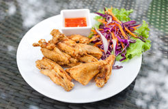 Tasty fried chicken in  white plates on glass table background Royalty Free Stock Images