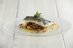 Tasty fried fish with mashed herbs Stock Photo