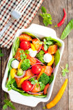 Tasty fried and grilled salmon  slices on mixed colorful vegetabl Stock Images