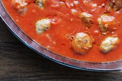 Tasty fried meatballs red tomato sauce stock images