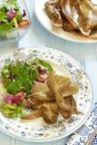 Fried pork ears with fresh salad Stock Photos