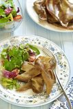 Fried pork ears with fresh salad Stock Images