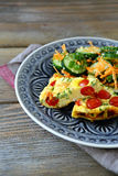 Tasty fritatta with cucumbers and carrots Royalty Free Stock Image