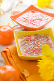 Tasty fruit jelly topped coconut shreds Stock Photo
