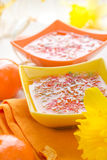 Tasty fruit jelly topped coconut shreds Royalty Free Stock Images