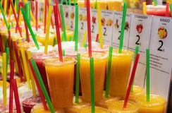 Tasty fruit Juice in ice smoothies at the Boqueria market in Barcelona. Tasty fruit smoothies at the Boqueria market in Barcelona royalty free stock photography