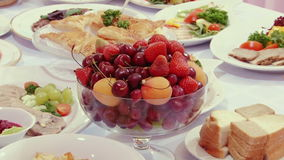 Tasty fruit - peaches, cherries, cherry on table. stock video footage