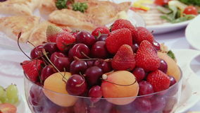 Tasty fruit - peaches, cherries, cherry on table. stock footage