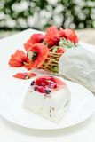 Tasty fruit pie and bouquet of poppy flowers on white table Royalty Free Stock Image