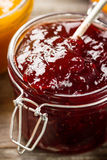 Tasty fruit red strawberry berry jams in glass jar with fruits o Stock Image
