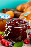 Tasty fruit red strawberry berry jams in glass jar with fruits o Stock Photography