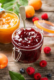 Tasty fruit red strawberry berry jams in glass jar with fruits o Stock Photos