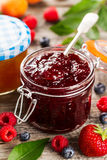 Tasty fruit red strawberry berry jams in glass jar with fruits o Royalty Free Stock Photography