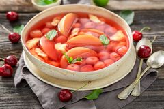 Tasty fruit soup in hot summer garden royalty free stock images