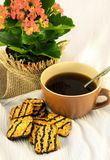 Tasty fruitcake and cup of coffee, flowers Stock Photography