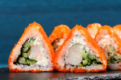 Tasty fusion rolls with orange tobiko roe, cream cheese and cucu Royalty Free Stock Images