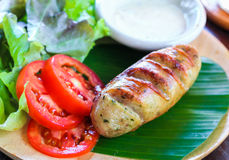 Tasty garlic sausage. With vegetables and cheese cream Stock Image