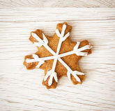 Tasty gingerbread star, wooden background Royalty Free Stock Image