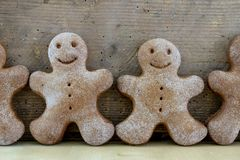 Tasty gingerbreads on a wooden table in the kitchen. Small cookies for Christmas royalty free stock photo