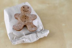 Tasty gingerbreads on a wooden table in the kitchen. Small cookies for Christmas royalty free stock image
