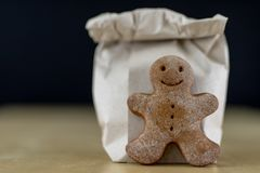 Tasty gingerbreads on a wooden table in the kitchen. Small cookies for Christmas royalty free stock photography