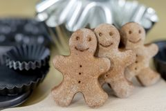 Tasty gingerbreads on a wooden table in the kitchen. Small cookies for Christmas stock images