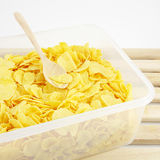 The tasty golden corn flakes in plastic container box Stock Images