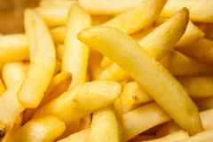 Tasty golden french fries on a plate. Royalty Free Stock Images