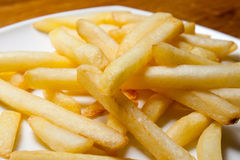 Tasty golden french fries on a plate. Royalty Free Stock Photo