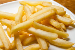 Tasty golden french fries on a plate. Stock Images