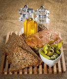 Tasty grain bread with olives, oil and spices Royalty Free Stock Photos