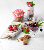 Tasty granola with nuts and yoghurt, sideview Stock Photo