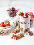 Tasty granola with nuts and yoghurt, sideview Royalty Free Stock Photography