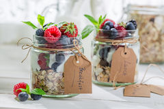 Tasty granola with yogurt and berry fruits Stock Images