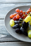 Tasty grapes mix on a plate Royalty Free Stock Photography