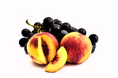 Tasty Grapes and Peaches. Nectarines. Royalty Free Stock Images