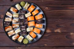 Tasty great set of japanese sushi maki rolls served on round pla. Te with free space for text design, flat lay. Food art, traditional seafood, restaurant menu Royalty Free Stock Photos