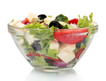 Tasty greek salad in transparent bowl Royalty Free Stock Images