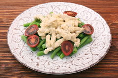 Tasty green beans with chicken meat and creamy sauce Stock Images
