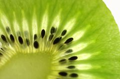 Tasty green fruit. A close-up of a very tasty, healthy tropical fruit, named kiwi Royalty Free Stock Photo