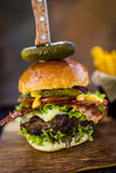 Tasty grilled beef burger with spinach lettuce and blue cheese s Royalty Free Stock Photos