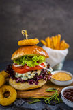 Tasty grilled beef burger with spinach lettuce and blue cheese s Royalty Free Stock Photography