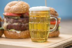 Tasty Grilled Burger And Glass Of Cold Beer Stock Photos