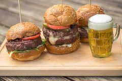 Tasty Grilled Burger And Glass Of Cold Beer. Royalty Free Stock Image