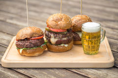 Tasty Grilled Burger And Glass Of Cold Beer. Stock Photography