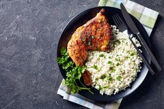Tasty grilled chicken leg with Cauliflower rice royalty free stock photography